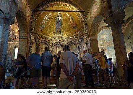 Trieste, Italy - 7 July 2018: People In The Chapel Dedicated To Saint Justus, San Giusto Basilica Ro