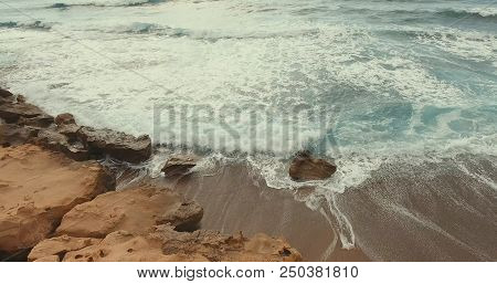 Aerial Photography. The Stone Shore Was Covered By A Sea Wave. Sunny Summer Day.