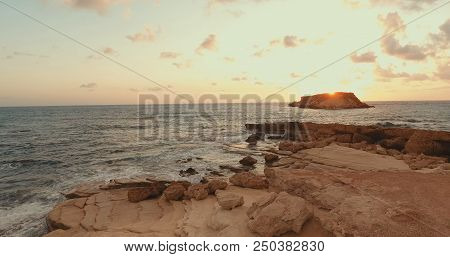 Aerial Photography. View From Above.  Waves Beat Against The Rocks. The Sky In Pink Tones. Horizon.f