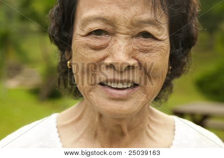 80's Asian senior woman at park in a morning