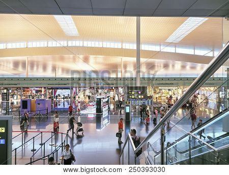 Passengers In Transit In A Terminal Of Barcelona International Airport.