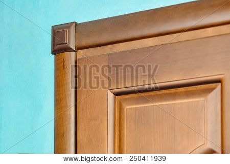 Element Of Wooden Door In Frame Of Brown Wood Carved Geometric Ornaments Classical Style On Blue Pla