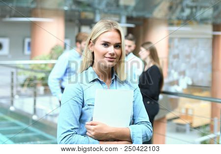 Business Woman In Casual Wear With Her Staff, People Group In Background At Modern Bright Office