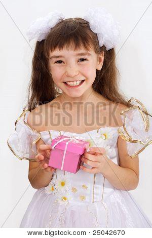 Little Laughing Girl Holding Christmas Present