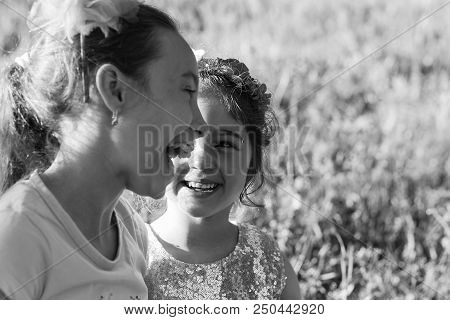 Two Happy Little Girls Laughing And Hugging At The  Summer Park. Happy Chidhood Concept. Black And W