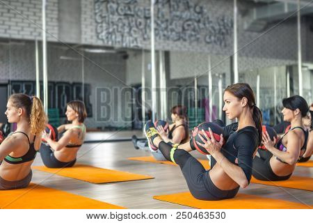 Fitness, Sport, Training, Gym And Lifestyle Concept - Group Of Young Woman Exercising In The Gym