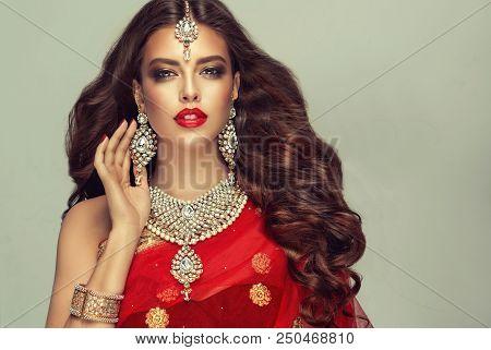 Portrait Of Beautiful Fashion  Indian Girl . Young Hindu Woman Model  In Kundan Jewelry . Traditiona