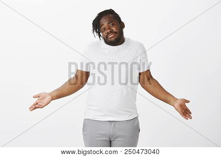 No Idea What Is Happening. Portrait Of Carefree Charming Plump Guy In Casual Outfit, Shrugging With