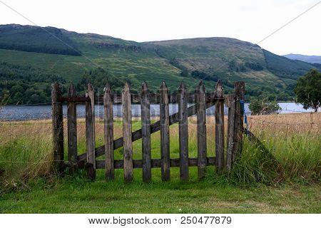 Old Wooden Gate To A Scottish Highland Loch