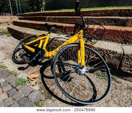 Milan, Italy - July 22, 2018: Close Up Of Damaged Tyre On Yellow Ofo Bike Sharing Milan, A Bike On T