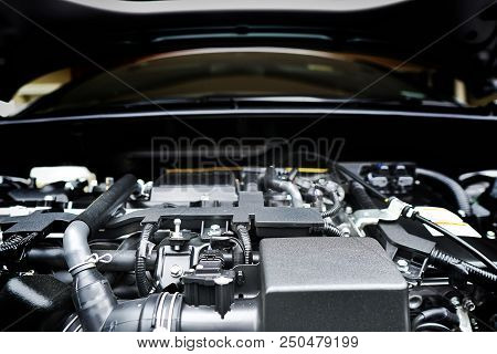 Close Up Of The Powerful Car Engine. Internal Design Of Engine. Automobile Metal New Car Engine Part