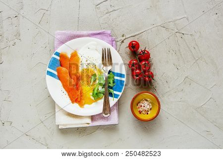 Flat Lay Of Tasty Smoked Salmon And Fried Eggs - Healthy Diet Breakfast On A Light Concrete Backgrou