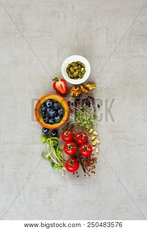 Flat Lay Of Healthy Clean Eating Food Selection. Micro Greens, Nuts, Seeds, Superfood, Berry, Tomato