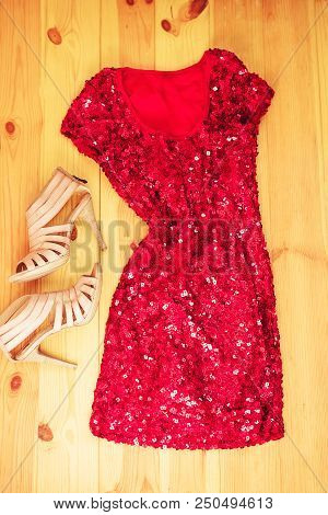 Red Dress On Wooden Background. Flat Lay, Top View. Woman Colorful Fashion Clothes And Accessory Con