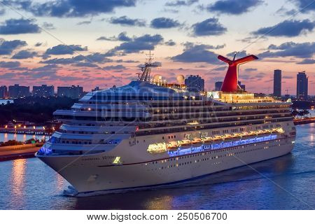 Miami, Florida - April 04 2014: Carnival Victory Cruise Ship Sailing At Sunrise In The Port Of Miami