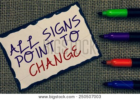 Text sign showing All Signs Point To Change. Conceptual photo Necessity of doing things differently new vision Blue bordered page drawn some texts laid color pen jute background poster