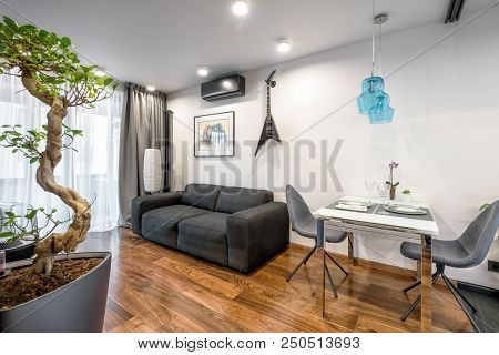 Moscow - March 25, 2018: Modern Home Interior With Couch, Table And Plants. Beautiful Minimalist Int