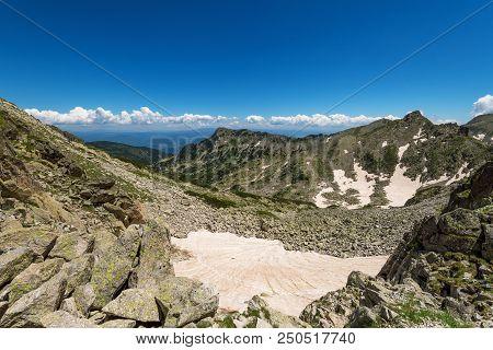 Difficult Hiking Trail Going Uphill Through The Rocks, Pirin Mountains, Bulgaria At Summerr.