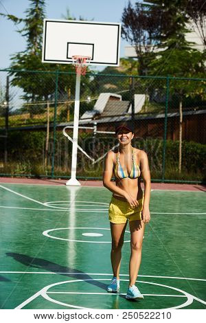 The Girl Basketball Player Have Training And Exercise At Basketball Court. Beautiful Young Woman Pla