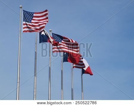 Three Sets Of American And State Flags Wave At The Exposition Plaza, The Traditional Line Between De