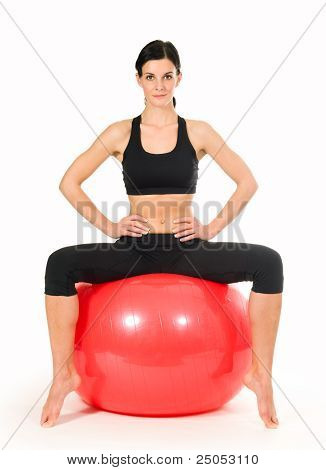 Brunette Woman Excercising With A Pilates Ball