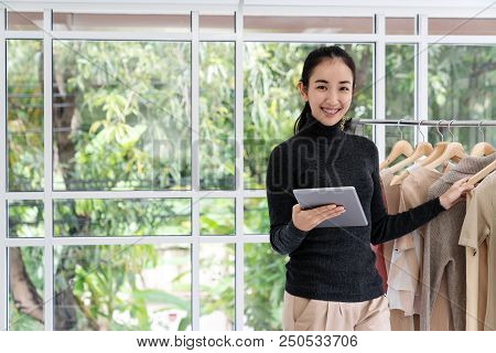 Young Asian Entrepreneur Woman Using Tablet Work At Home Office Looking At Camera With Happy Casual
