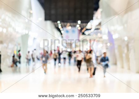 Crowd Of Anonymous Abstract Blurred And Defocused People At Airport, Trade Fair Or Trade Show Exhibi