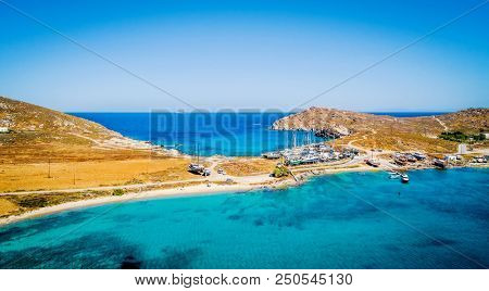 Aerial panoramic view of quay with sailing boats on trailers on the shore of Paros island, Greece. Boats launching process