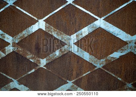 Background Of Rusted Vintage Metal With A Diamond Pattern And Vintage Blue Paint