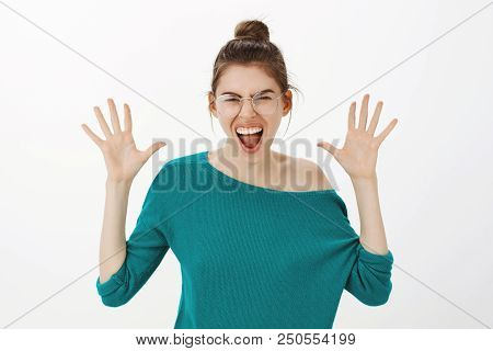Jazz Hands Never Come Out Of Style. Portrait Of Joyful Carefree Caucasian Woman In Eyewear And Loose