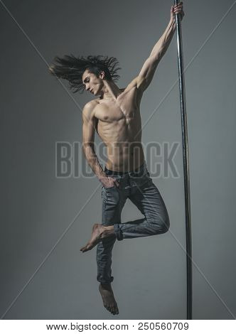 Athletic Man Make Acrobatic Elements On Pylon. Dieting. Sexy Macho Dancer Workout On Pole. Working H