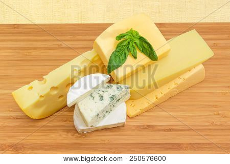 Pieces Of Different Soft And Semi-soft Cheese With Mold, Medium-hard Cheese, Swiss-type Cheese And H