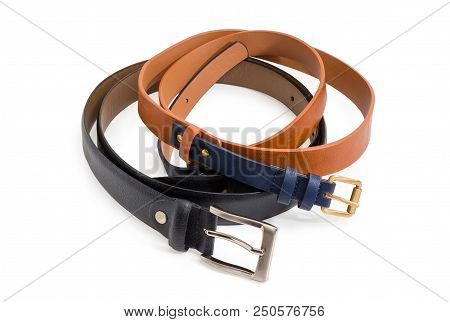 Brown-black belt for women made of synthetic material imitating the leather and black leather belt for men with conventional buckles on a white background poster