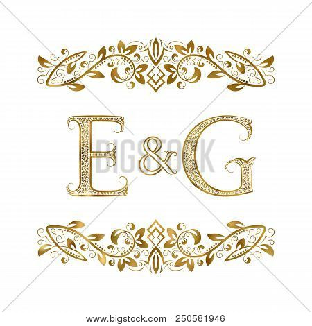 E And G Vintage Initials Logo Symbol. The Letters Are Surrounded By Ornamental Elements. Wedding Or