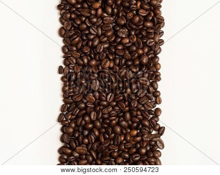 Coffee Beans Stripe With White Background On Both Sides. Coffee Background Or Texture Concept. Copys
