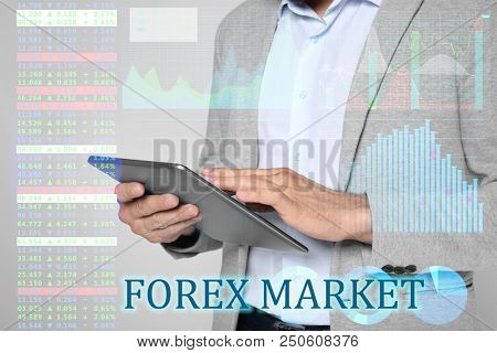 Double exposure of graphs, rates and financial trader working with tablet on light background. Forex concept poster