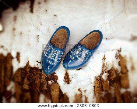 Blue white decorated wooden clogs in village Zaanse Schans in Netherlands poster