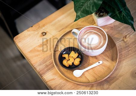 Cup Of Hot Cocoa (coffee Or Latte) Decorated With Milk Forth On The Surface Placed On A Wooden Tray,