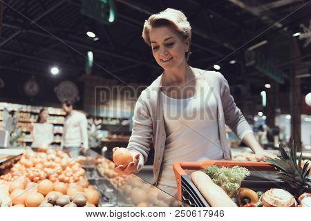 Woman With Shopping Cart Choosing Fruits In Shop. Woman With Shopping Trolley. Shopping Cart With Fo