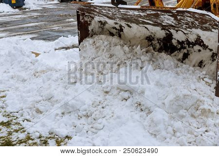 Large Bucket Wheel Excavator For Snow Removal On A Snowy Parking Lot After A Blizzard In The Tractor