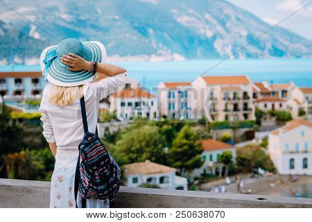 Tourist Woman Admiring View Of Colorful Tranquil Village Assos On Morning. Young Stylish Female Mode