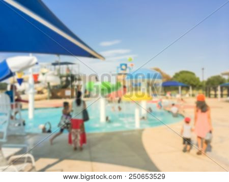 Abstract Blurred Outdoor Pools With Play Area, Slides, And Lap Lanes