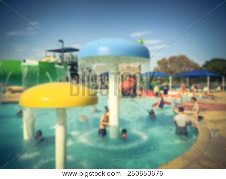 Abstract Blurred Kids And Parents At Water Park Aquatic