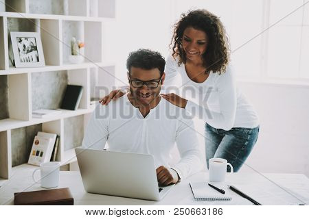 Young Pakistani Freelancer With Wife Working At Home. Husband In Glasses. Young Family Concept. Free