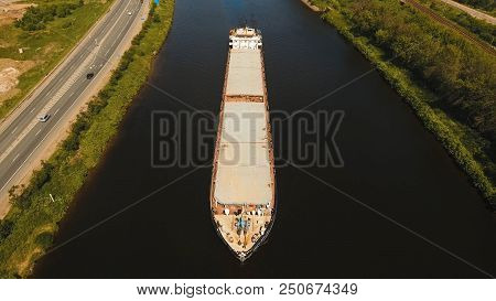 Aerial View:barge With Cargo On The River. River, Cargo Barge, Highway With Cars.. Cargo Ship On The
