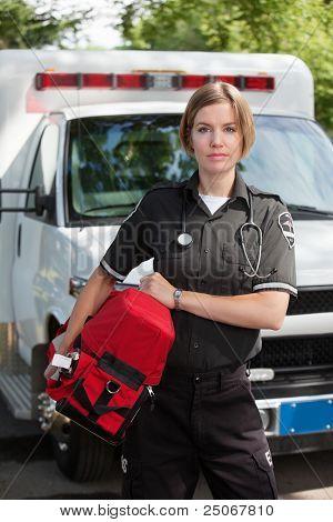 Portrait of an EMS professional carrying a protable oxygen unit