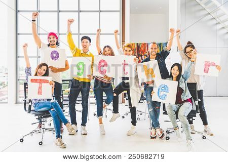 Multiethnic Diverse Group Office Coworker Or Creative People Hold Word Together, Cheer And Celebrate
