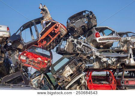 Old cars stack - Car junkyard - damaged vehicles waiting for metal recycling