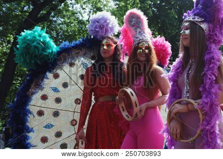 ST. PETERSBURG, RUSSIA - MAY 27, 2018: Girls with tambourines on Nevsky avenue during Drummers parade. The parade is a part of City Day celebrations which is timed to the day of foundation of the city