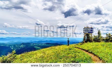 Senior Woman Hiking On Tod Mountain Near The Alpine Village Of Sun Peaks In The Shuswap Highlands Of
